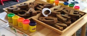A table with large bock letters and play-doh