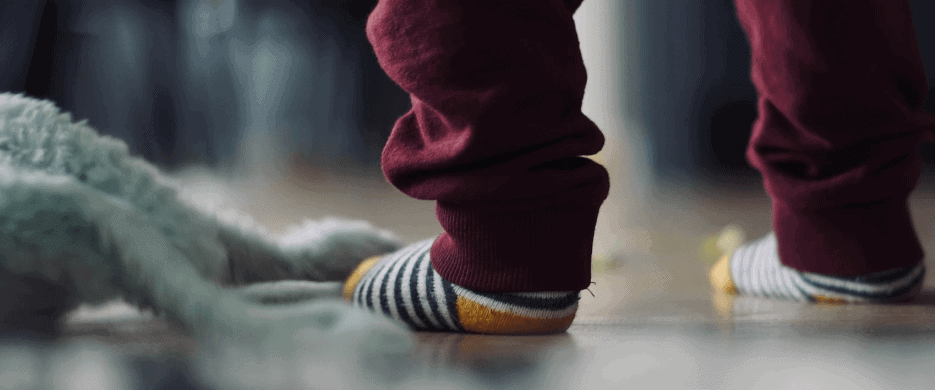 Young Toddler legs with pajamas and socks