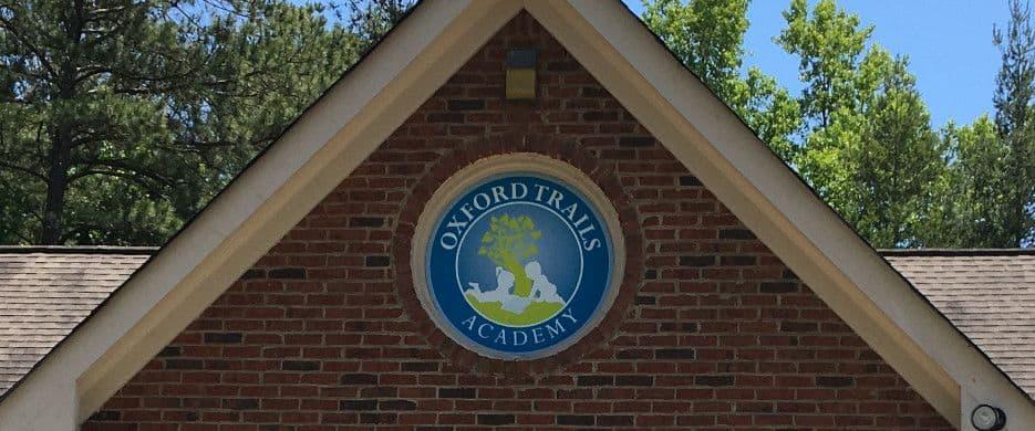 Oxford Trails Academy logo on the school building.